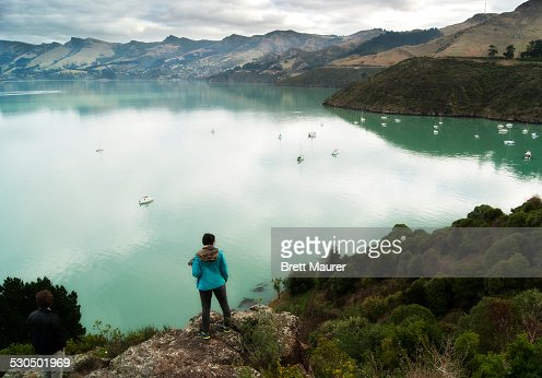 Traveler overlooking Lyttelton Harbour New Zealan