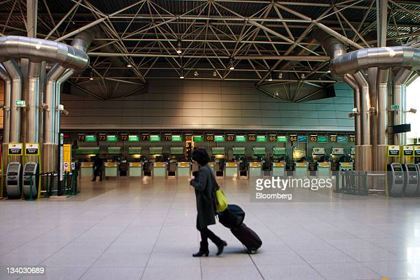 A traveler passes an empty checkin area at Lisbon airport during a general strike in Lisbon Portugal on Thursday Nov 24 2011 Portugal braces for its...