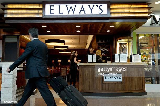 A traveler passes Elway's restaurant at Denver International Airport in Denver CO June 12 2013
