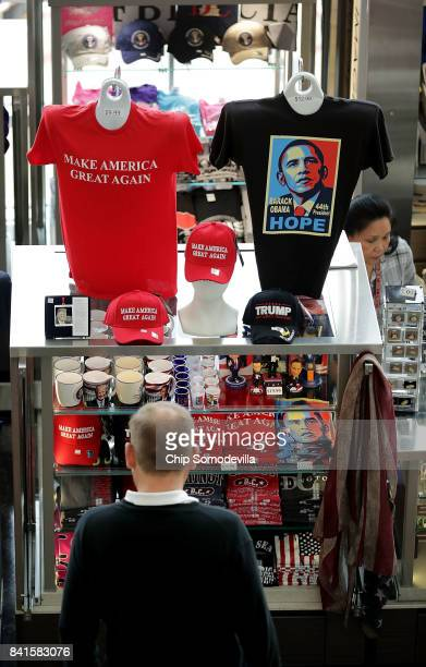 A traveler pauses to look at political merchandise at Ronald Reagan National Airport's Terminal B and C September 1 2017 in Washington DC More than...