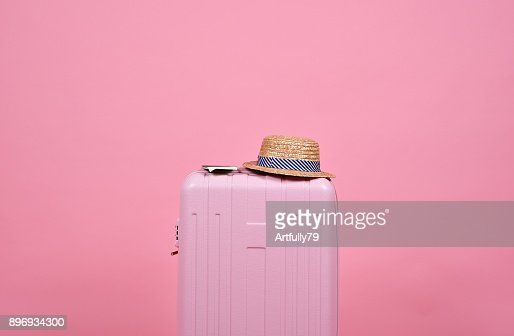 Traveler pink suitcase and passport document over pink background, Journey and travel concept. : Stock Photo