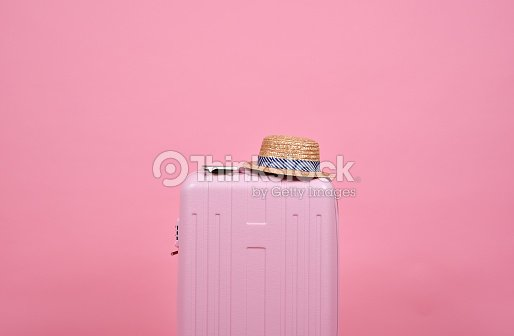 Traveler pink suitcase and passport document over pink background, Journey and travel concept. : Foto de stock