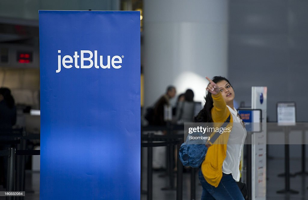 A traveler points to the JetBlue Airways Corp. check-in counter at San Francisco International Airport in San Francisco, California, U.S., on Monday, Jan. 28, 2013. JetBlue Airways Corp. fell the most in about two months after fourth-quarter profit tumbled 96 percent, more than analysts projected, as superstorm Sandy forced flight cancellations and reduced travel demand. Photographer: David Paul Morris/Bloomberg via Getty Images