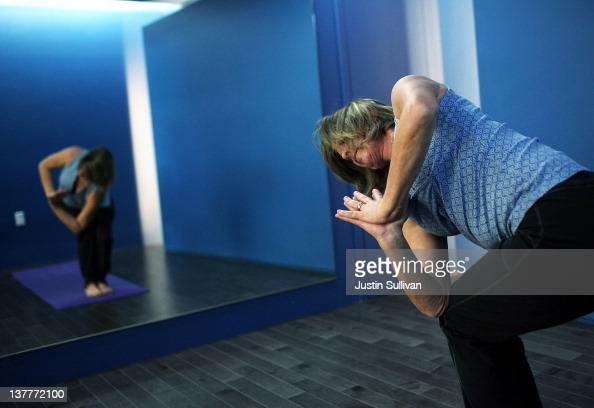 A traveler pratices yoga inside the new Yoga Room at San Francisco International Airport's terminal two on January 26 2012 in San Francisco...