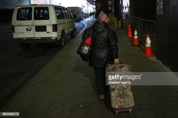 A traveler pulls her luggage towards New York Port Authority after an explosion occured in Manhattan borough of New York City United States on...