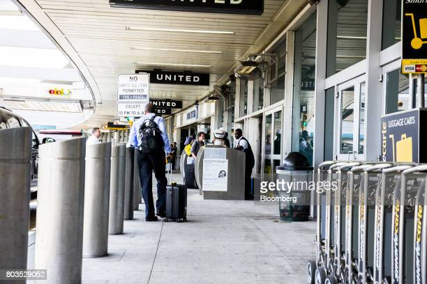 A traveler stands next to luggage at LaGuardia Airport in New York US on Thursday June 29 2017 The Trump administration provided details of its...