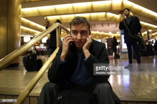 A traveler talks on phone after New York Port Authority was reopened after an explosion occured in Manhattan borough of New York City United States...