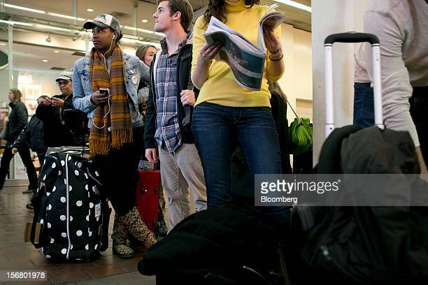 Traveler T'Keyah Slaten left waits to board an Amtrak train at Union Station in Washington DC US on Wednesday Nov 21 2012 US travel during the...