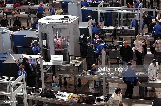 A traveler undergoes a full body scan performed by Transportation Security Administration agents at the Denver International Airport on November 22...