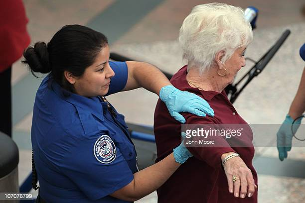 A traveler undergoes an enhanced pat down by a Transportation Security Administration agent at the Denver International Airport on November 22 2010...