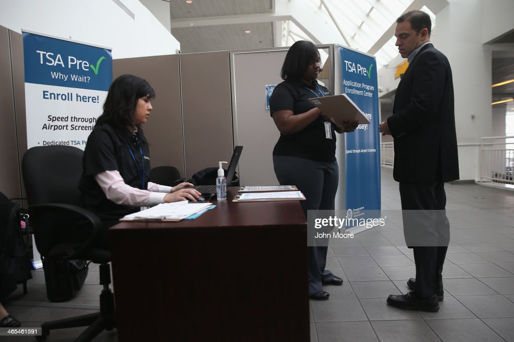 A traveler visits a newly-opened TSA Pre-check application center at LaGuardia Airport on January 27, 2014 in New York City. Once approved for the program, travelers can use special expidited Precheck security lanes. They can also leave on their shoes, light outerwear and belt, as well as keep their laptop and small containers of liquids inside carry-on luggage during security screening. The TSA plans to open more than 300 application centers across the country.