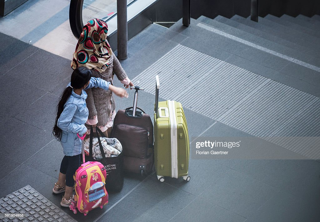 Traveler wait with their suitcases at the central station on August 19 2016 in Berlin Germany