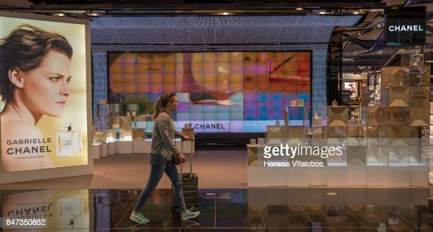 A traveler walks by the Chanel stand in duty free area of Terminal 1 of Barcelona El Prat Airport on September 10 2017 in Barcelona Spain Barcelona...