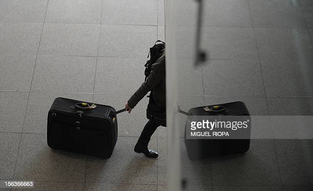 A traveler walks by the empty hall of Lisbon Airport during a general strike on November 14 2012 General strikes in Spain and Portugal will spearhead...