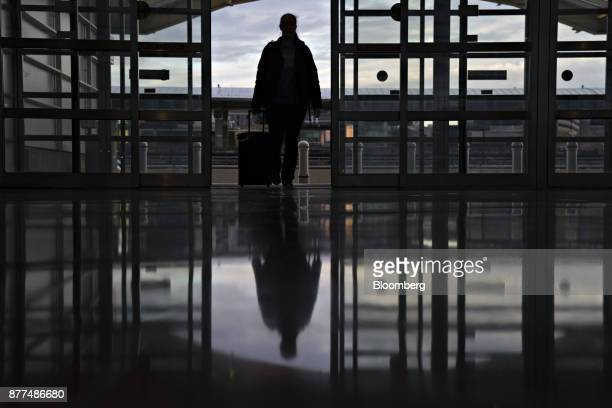 A traveler walks into Ronald Reagan National Airport in Washington DC US on Wednesday Nov 22 2017 The trade association Airlines for America has...