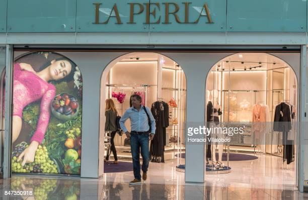 A traveler walks out of La Perla store at departures main hall of Terminal 1 of Barcelona El Prat Airport on September 10 2017 in Barcelona Spain...