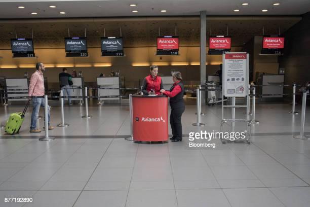 A traveler walks towards the Avianca Holdings SA ticket counter at El Dorado International Airport in Bogota Colombia on Tuesday Oct 31 2017 Avianca...