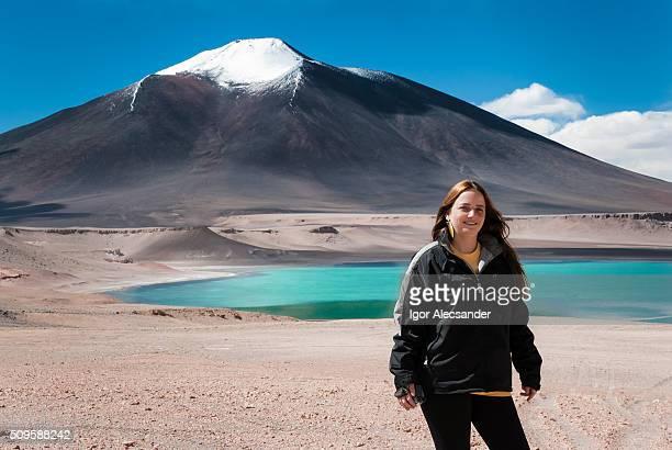 Traveler woman at Laguna Verde or Green Lake, Andes, Atacama, Chile