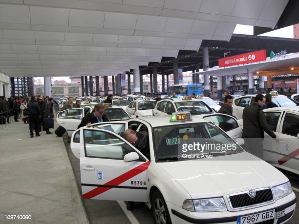 Travelers accessing taxis in the arrivals terminal Puerta de Atocha station Madrid Spain january 2011