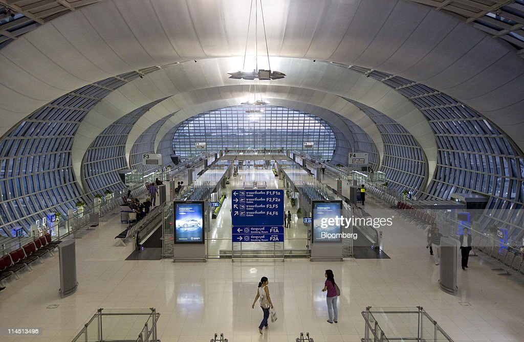 Travelers are seen inside Suvarnabhumi Airport in Bangkok Thailand on Sunday May 8 2011 Thailand's Cabinet approved a plan worth about 62 billion...
