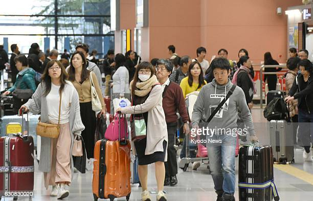 Travelers arrive at Kansai International Airport in western Japan on Jan 3 after spending their New Year holidays abroad