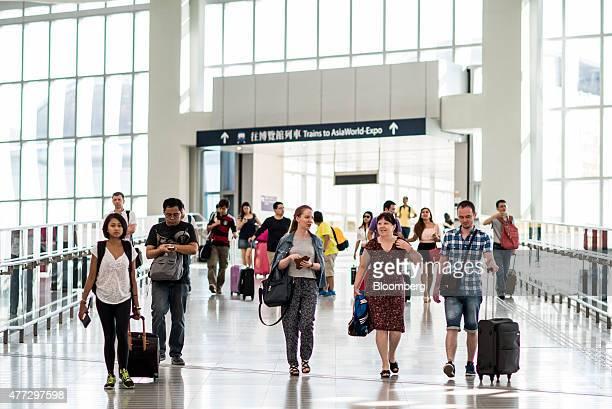 Travelers arrive at Terminal 2 of Hong Kong International Airport in Hong Kong China on Monday June 15 2015 The Hong Kong government in March...