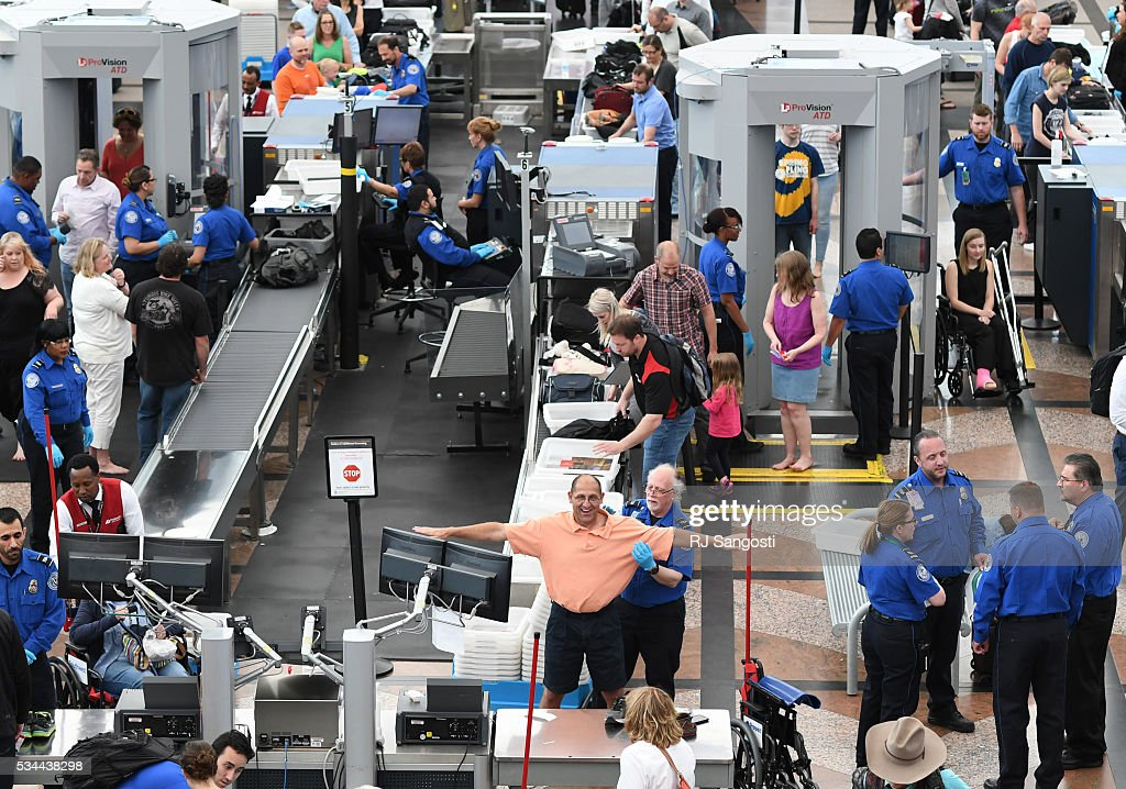 Travelers, at Denver International Airport, make there way through security lines as people start traveling for the long Memorial Day weekend, May 26, 2016. Officials at Denver International Airport are planing to see over million travelers during the Memorial Day weekend. Cutbacks in the Transportation Security Administration have caused thousands of travelers to miss their flights across the country.