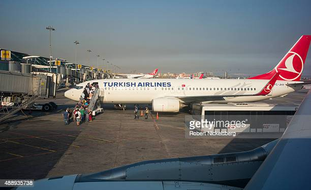 Travelers board a Turkish Airlines jet plane September 5 2015 at the Istanbul Ataturk Airport in Istanbul Turkey