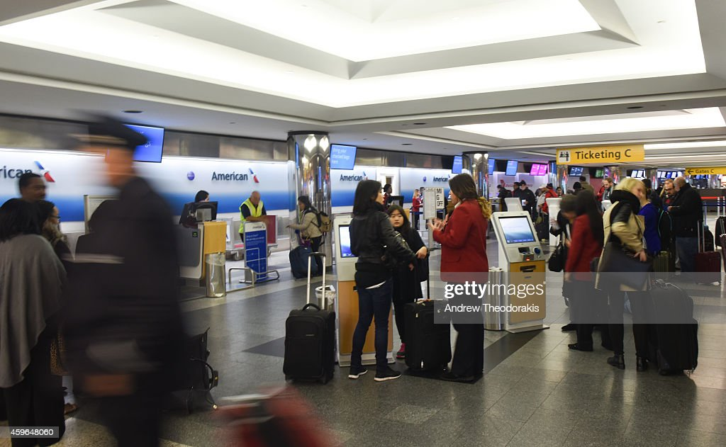 Travelers check in to board flights on Thanksgiving Day November 27 2014 at LaGuardia Airport in the Queens borough of New York City New York Despite...