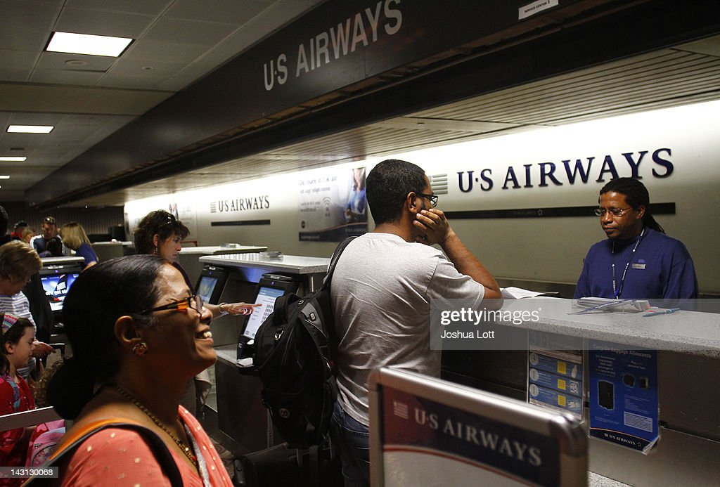 The transition from US Airways to American Airlines was relatively smooth. Passengers were notified well in advance. It wasn't as if people were waiting in the US Airways check-in line only to find out that their flight was cancelled forever.