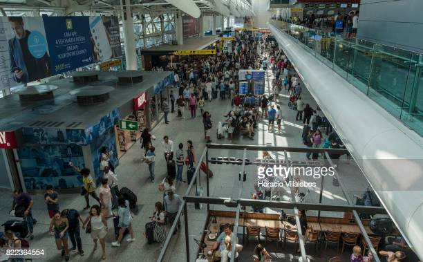 Travelers crowd arrivals hall at Terminal 1 of the Humberto Delgado International Airport on July 25 2017 in Lisbon Portugal The Portuguese tourist...