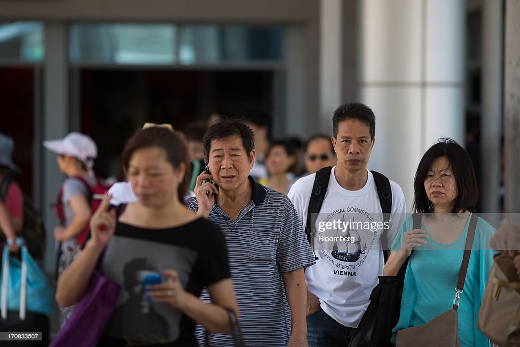 Travelers exit the Zhuhai-Macau border crossing in Macau, China, on Tuesday, June 18, 2013. Casino revenue in Macau, the only place in China where casino gambling is legal, rose 14 percent to a record of 304 billion patacas ($38 billion) in 2012. Photographer: Lam Yik Fei/Bloomberg via Getty Images