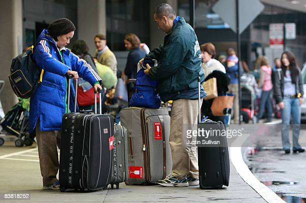 Travelers gather their luggage before checking in for a flight at San Francisco International Airport November 25 2008 in San Francisco California As...