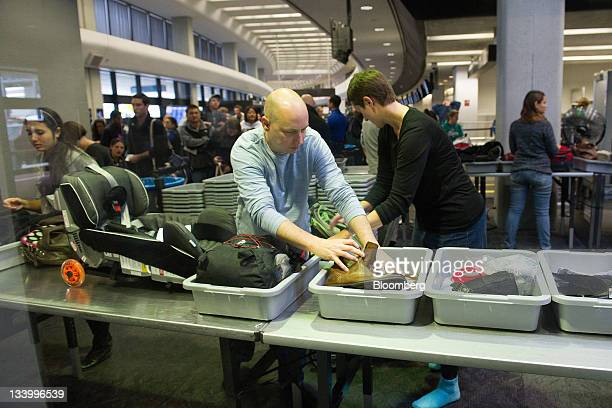Travelers go through security in the departure hall at San Francisco International Airport in San Francisco California US on Wednesday Nov 23 2011...
