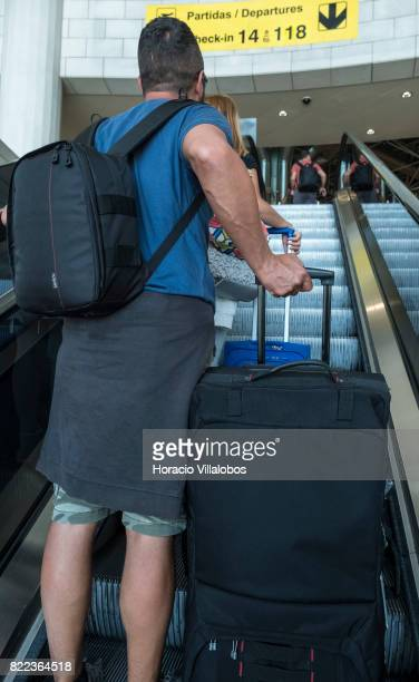 Travelers in departures hall at Terminal 1 of the Humberto Delgado International Airport on July 25 2017 in Lisbon Portugal The Portuguese tourist...