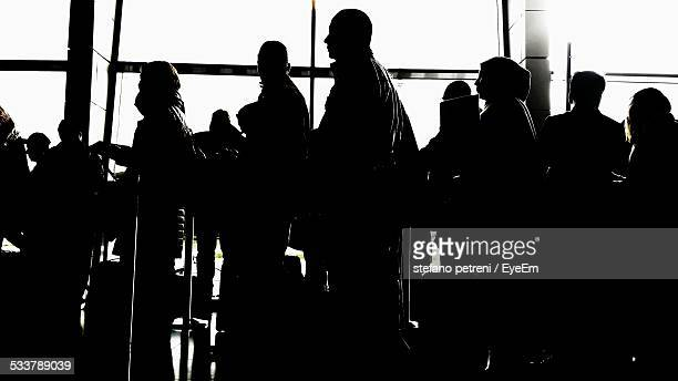Travelers In Line At Airport