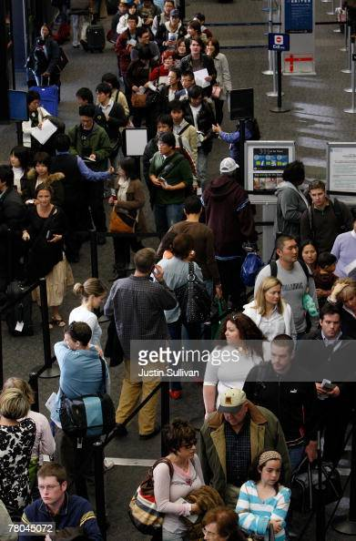 Travelers line up at a security check point in San Francisco International Airport November 21 2007 in San Francisco California On one of the busiest...