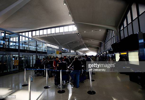 Travelers line up at ticketing counters at Newark Liberty International Airport Terminal B following a major blizzard on December 27 2010 in Newark...