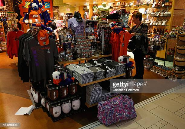 Travelers look at Super Bowl XLIX merchandise at Phoenix Sky Harbor International Airport on January 19 2015 in Phoenix Arizona The NFL Super Bowl...