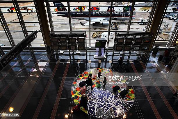 Travelers make their way to flights in the concourse of Ronald Reagan Washington National Airport on one of the nation's busiest travel days of the...
