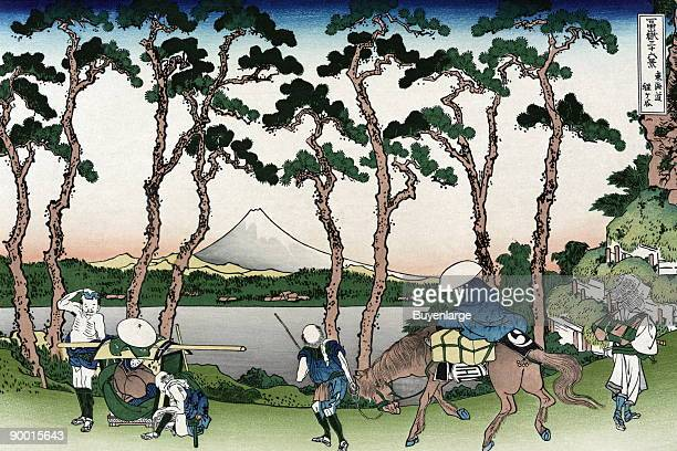Travelers move along the Tokaido Road with a Sedan chair and horses