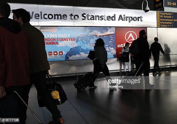 Travelers pass a welcome sign at the checkin area at London Stansted Airport operated by Manchester Airports Group in Stansted UK on Friday Oct 28...