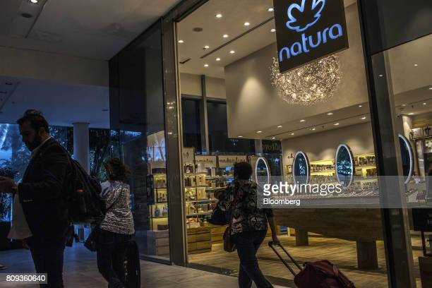 Travelers pass in front of a Natura Cosmeticos SA store inside the Santos Dumont Airport in Rio de Janeiro Brazil on Monday June 25 2017 British...