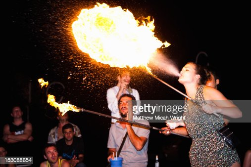 Travelers practicing fire breathing.