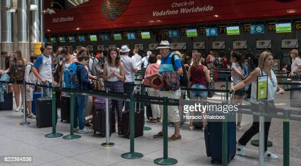 Travelers queue before TAP Portugal desks in departures hall at Terminal 1 of the Humberto Delgado International Airport on July 25 2017 in Lisbon...