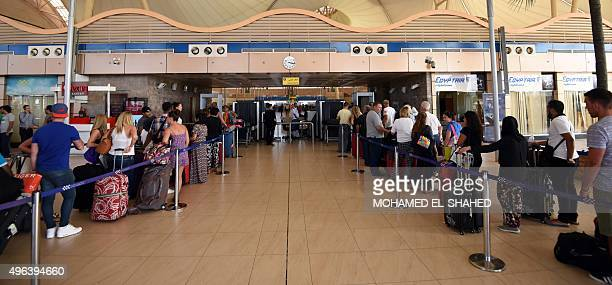 Travelers queue for British and Russian flights at the airport in Egypt's Red Sea resort of Sharm ElSheikh on November 9 2015 Tens of thousands of...