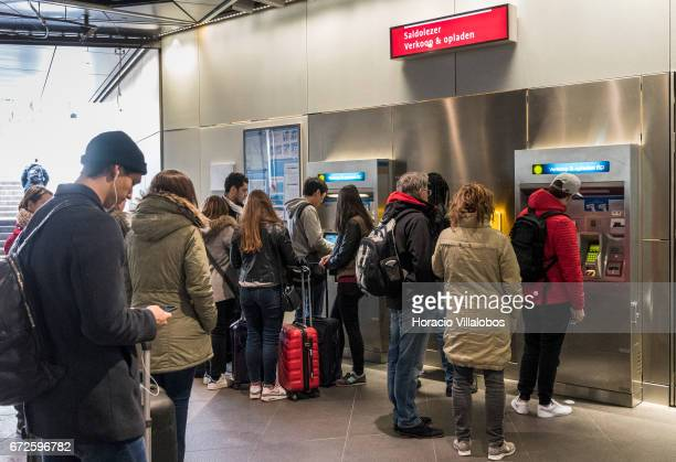 Travelers queue to buy tickets at Metro Central Station on April 22 2017 in Amsterdam Netherlands The city's Metro system was first introduced in...