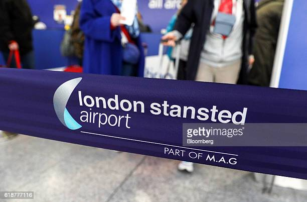 Travelers queue to pay for bus tickets at London Stansted Airport operated by Manchester Airports Group in Stansted UK on Friday Oct 28 2016 Ryanair...