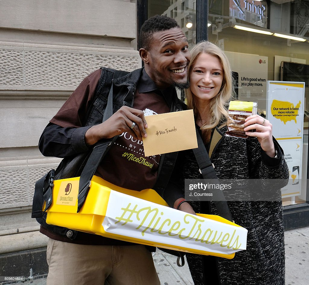 Travelers receive cookies and free hotel stays from DoubleTree by Hilton on National Pay it Forward Day during the 'Nice Travels' Launch on April 28, 2016 in New York City.