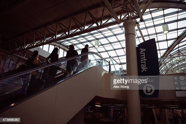 Travelers ride an escalator at Union Station May 18 2015 in Washington DC Amtrak has restored its normal service on the Northeast Corridor this...